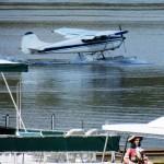 Plane landing by Dock Store